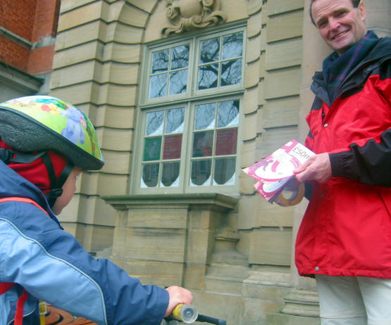 Sustrans Ranger, Richard, canvassing with a small child on a bike listening