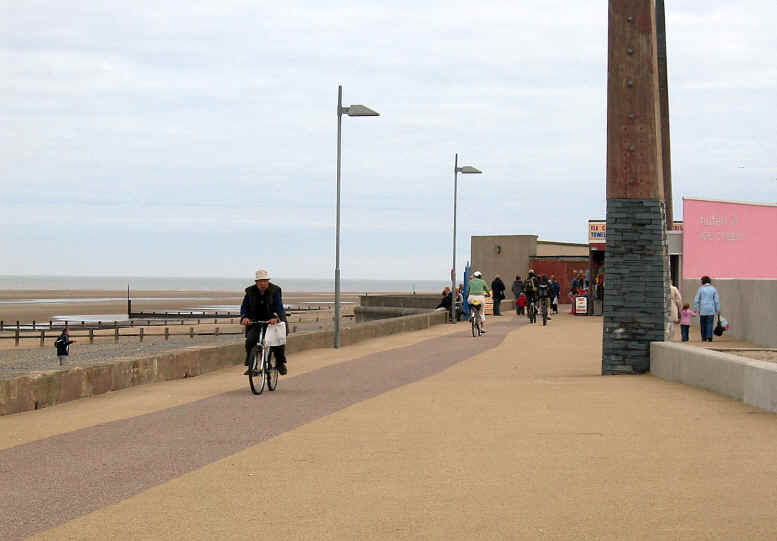 Photo of people cycling on Rhyl promenade