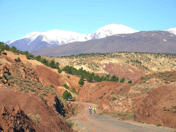 Photo of cyclists climbing a pass in the Atlas mountains, Morocco