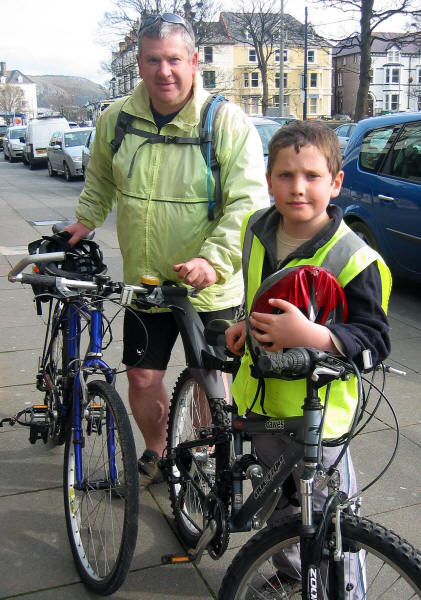 Tim Cunningham and son with cycles in Llandudno