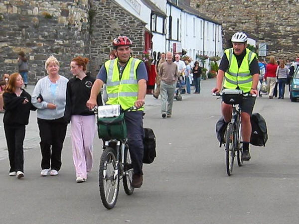 Photo of two cyclists cycling on Conwy quay