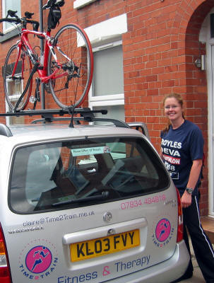 With her bike on a roof rack, Claire gets in her car to go to train