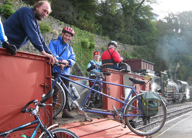 Loading a tandem on to open bike wagon of Welsh Highland  Railway