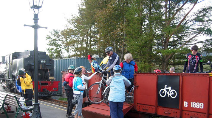 At Rhyd Ddu the cyclist unload their own bikes from the Welsh Highland  Railway's bike wagon