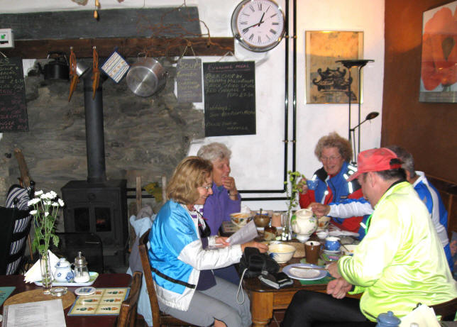 Cyclists have refreshments at the Ty Mawr cafe and Bed and Breakfast at Rhy Ddu