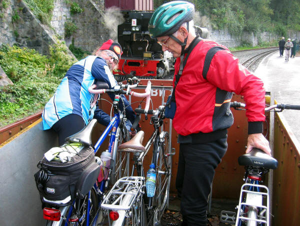 Fastening bikes in a wagon on the Welsh Highland Railway